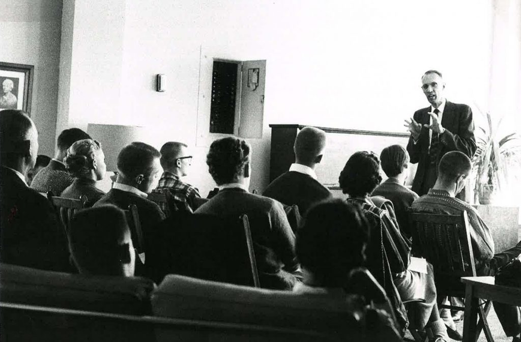 Dr. Hall in the classroom with his students
